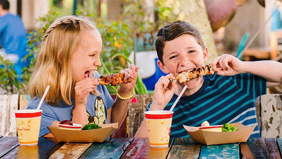 Children enjoying a meal at Harambe Market in Disney's Animal Kingdom