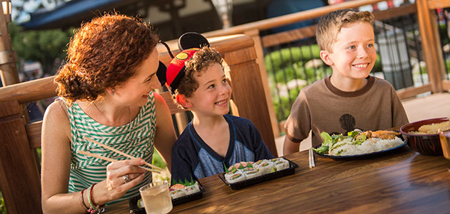 Family enjoying sushi at the Japan Pavilion in Epcot