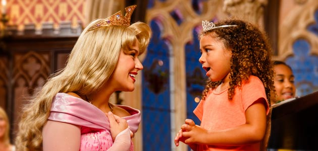 Girl with Sleeping Beauty at Cinderella's Royal Table