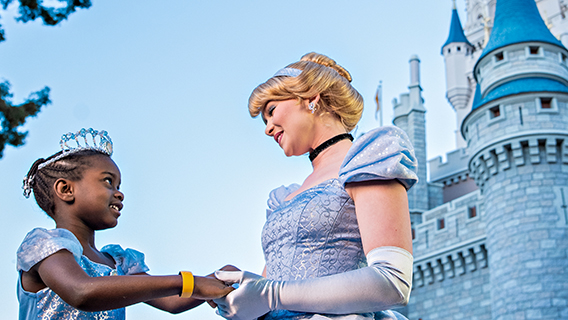 Young girl meets Cinderella in Fantasyland